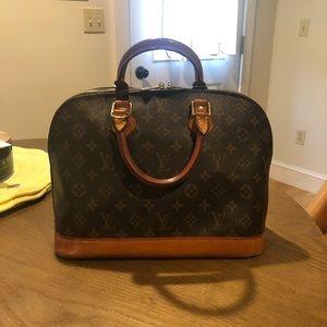 100% authentic Louis Vuitton Alma Purse